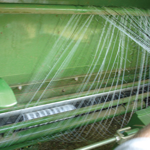 Net wrapping on feeding rollers